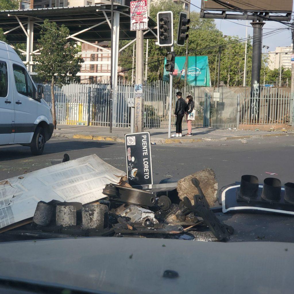 Protest debris on Av. Santa María