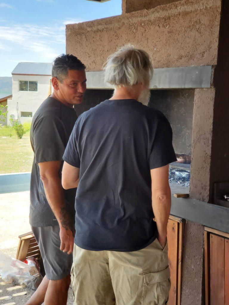 Alberto and John discussing asado, Los Reartes, Argentina